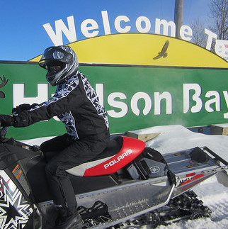 Corrina Kapeller pictured at the entrance to Hudson Bay in 2014. The Hudson Bay Trail Riders hosted the CEO of Tourism Saskatchewan and Marketing Manager that year.