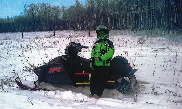 person on a snowmobile in Interlake region of Manitoba