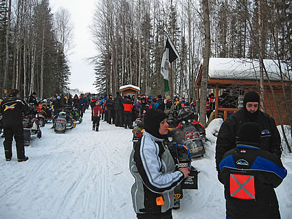 People gathered together on sleds