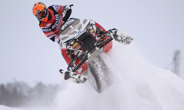 Jake Scott jumps through a corner during a snocross race.