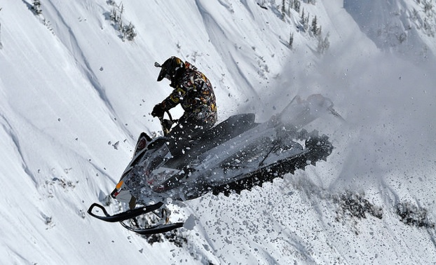 Jeremy Hanke executing a jump on his snowmobile.
