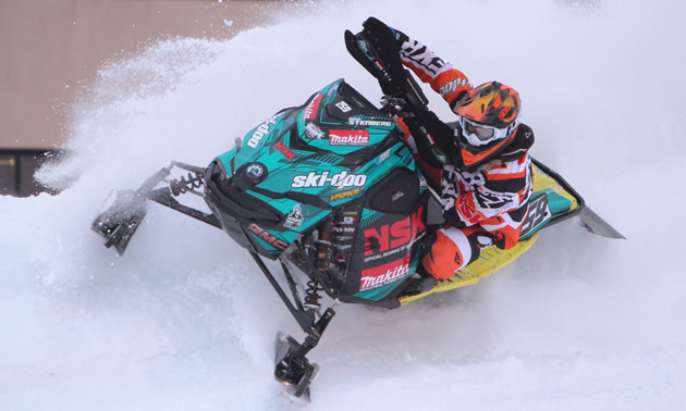 John Stenberg snocross racer takes the outside line in a race.