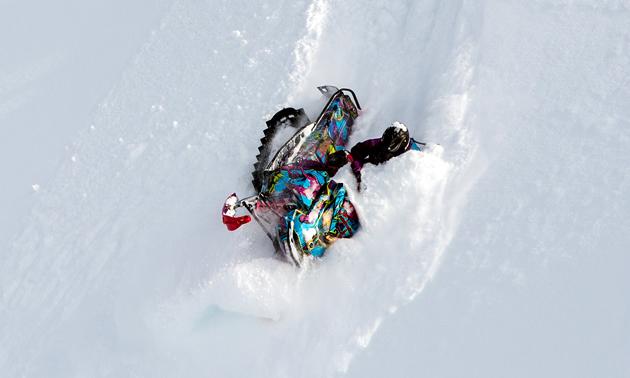Kelsey Elliott carving a steep downhill descent.