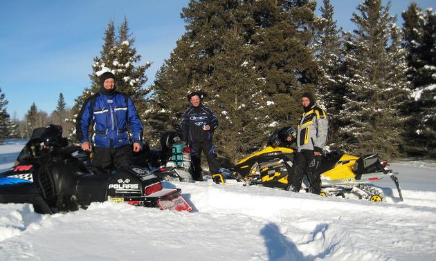 Guys snowmobiling around Lac du Bonnet