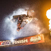 Levi LaVallee doing a backflip at snocross.
