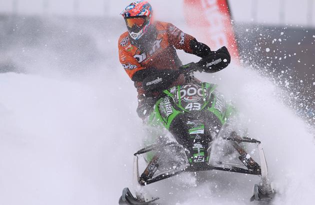 Logan Christian snocross racer powers through a corner in a race.