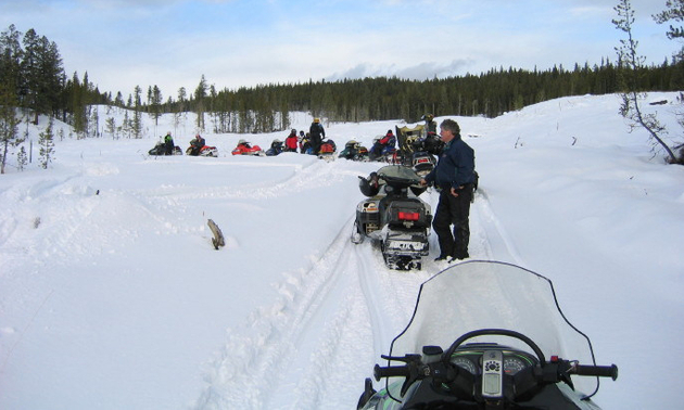 A line of snowmobilers in the Logan Lake area enjoy the great snow conditions.