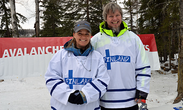 Lori Zacaruk and Brent Strand wearing Finland jerseys.