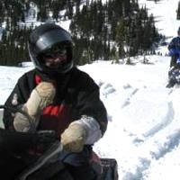 Friends enjoy snowmobiling in Mackenzie.