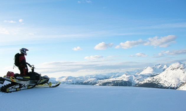 A snowmobiler admires the view from on top of Morfee Mountain near Mackenzie, BC.