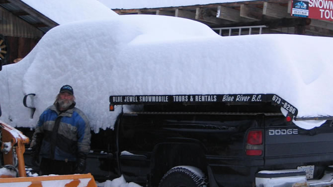 A truck showing one metre of snow dumped on it overnight