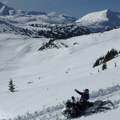 sledder on a snowy mountain in McBride
