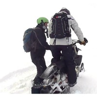 Snow Bike Mentor Rob Rae showing Trish Drinkle the how to's of snow biking.