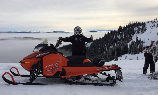 Laura Rasmussen gives a thumbs up sign from her Ski-Doo while sledding in the Merritt area.