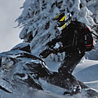 person riding a sled through powder