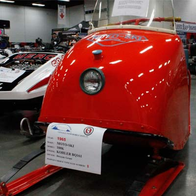 Cherry red 1965 Moto-Ski sled.