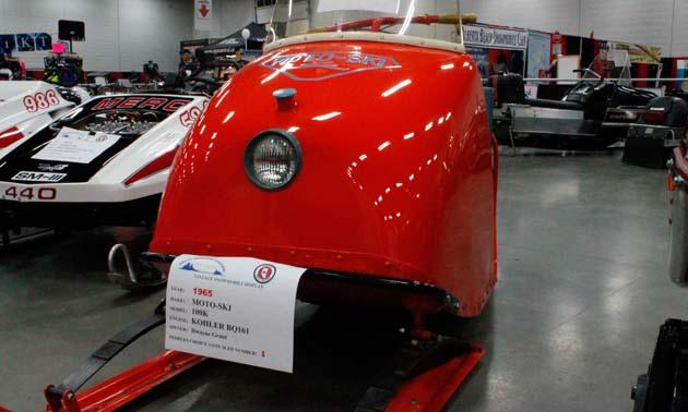 Cherry red 1965 Moto-Ski sled.