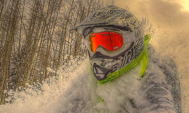 A rider flying through deep snow with a Nekkr on.