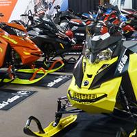 New 2016 Ski-Doo and Polaris snowmobiles on display.