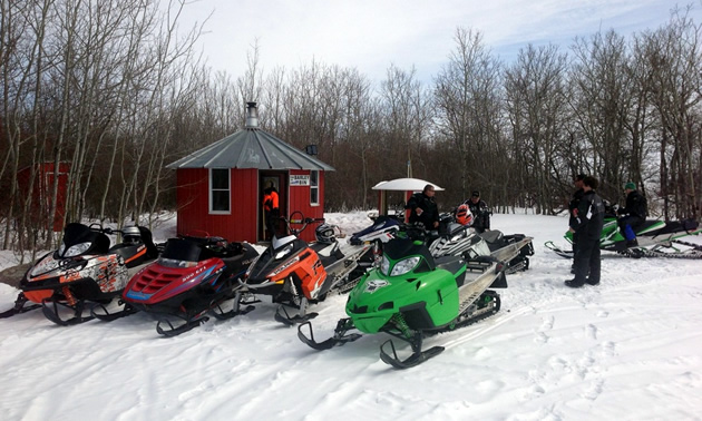 Snowmobilers parked at the Barley Bin warm up shelter.