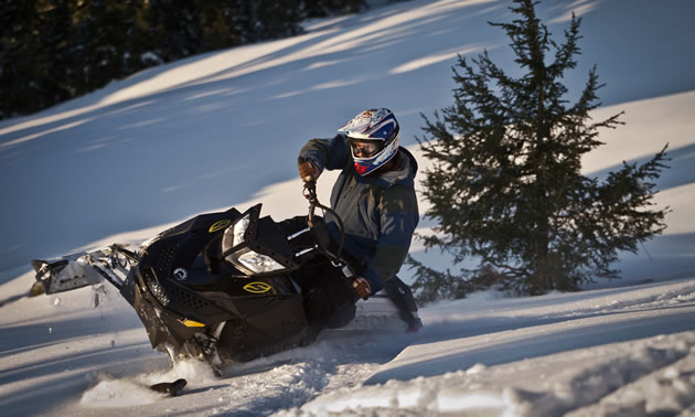 Photo of a guy sidehilling with a black sled.