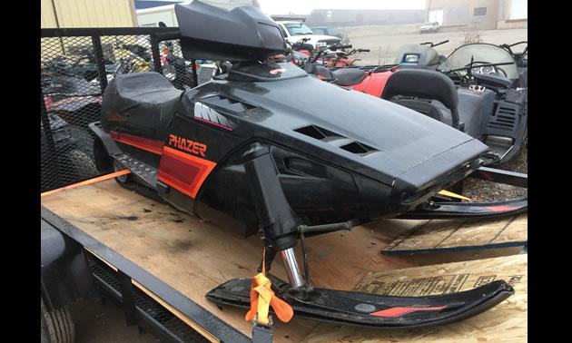A Yamaha Phazer on a snowmobile trailer