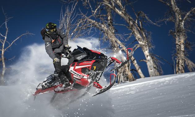 A snowmobiler airing out the new Polaris Patriot 850.