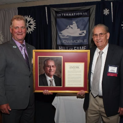 Schmier on the right accepting his award.