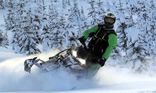 A mountain sledder carves fresh powder in the BC backcountry.