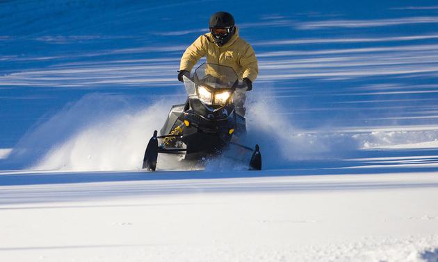 Snowmobiling in the Waskesiu Wilderness Region near Elkridge Resort.  Photo by Tourism Saskatchewan/Greg Huszar Photography