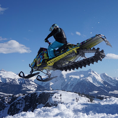 Stephanie Schwartz sails away into the deep blue sky on her sled in Revelstoke.