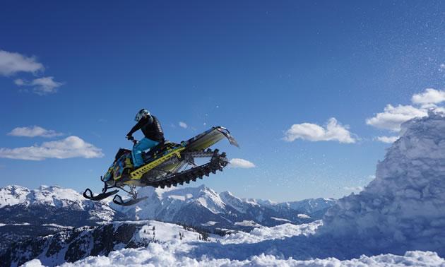 Stephanie Schwartz sails away into the deep blue sky on her sled in Revelstoke.