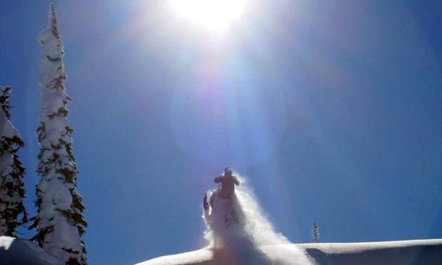 Randy Swenson riding into the sunlight in Revelstoke.