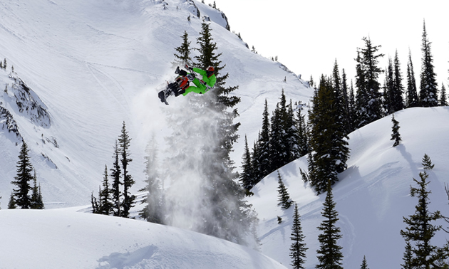 Reagan Sieg sending his Timbersled snow bike over a jump in the mountains.