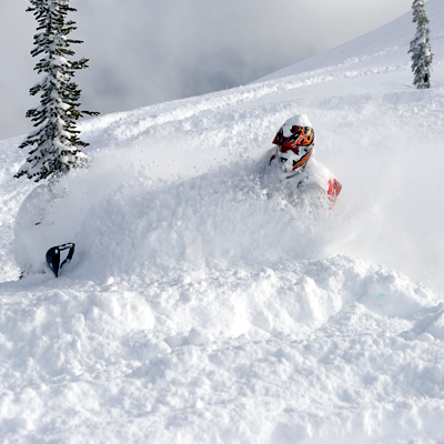 Snowmobiler getting a face full of powder in Revelstoke.