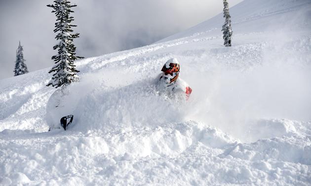 Snowmobiler getting a face full of powder in Revelstoke.