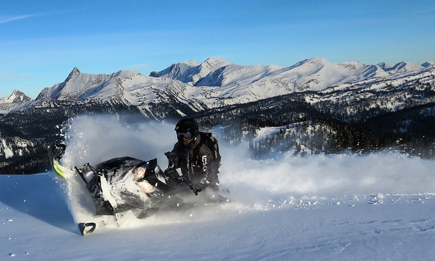 A snowmobiler is sledding in Revelstoke at Keystone Mountain.