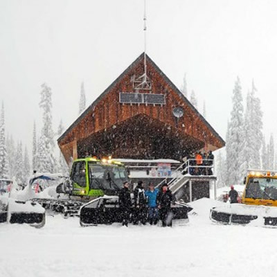 Boulder Mountain cabin with groomers parked out front.