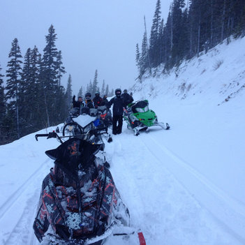 The club and some local riders break trail into Wolverine.