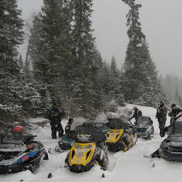 Snowmobilers explore the forest trails near Lac du Bonnet.
