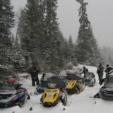 Snowmobilers explore the forest trails near Lac du Bonnet.