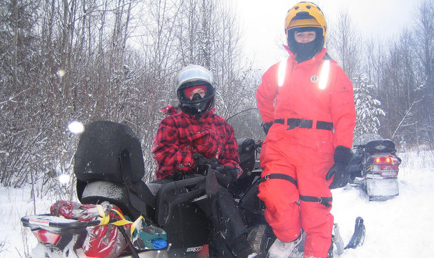 Heading out to explore the trails of the Elk Ridge area. Even a bad day snowmobiling is a good one for the Punshon family. Photo by Kevin Punshon