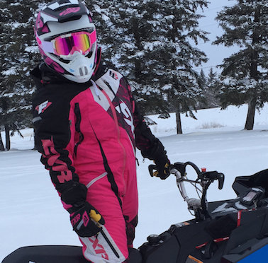 Sasha Bodie is ready to rip on her 2016 Polaris SKS 800 155 decked out in FXR Racing gear.
