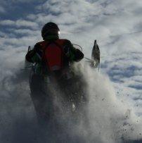 A sledder catching some air on the Saskatoon Snowmobile Club's trails.