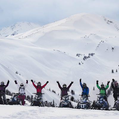 Picture of group of women snowmobilers.