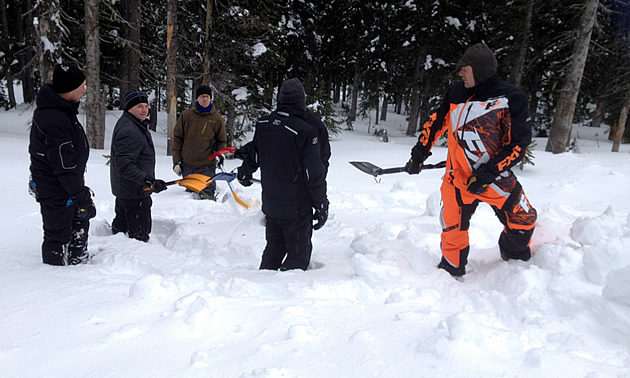 A group of avalanche trainees learning how to keep rescuers spaced out when shovelling.