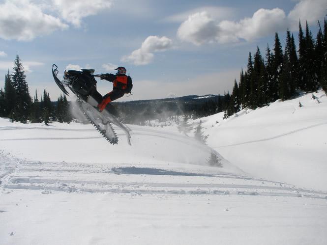 man riding a sled