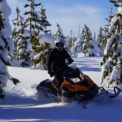 Picture of snowmobiler in deep powder.