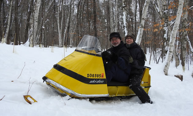 Bruce and Ellen Hostetler sitting on bright yellow Ski-Doo.