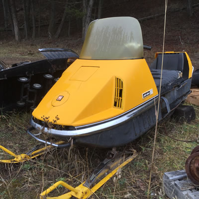 A bright yellow vintage Ski-Doo 399 Olympic Nordic.